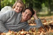 Couple lying in the leaves