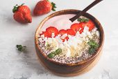 Strawberry Pink Smoothies Bowl With Banana, Coconut And Chia Seeds. Healthy Vegan Food Concept. poster