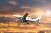 Airplane Flying In The Sunset Sky, Travel Background With Commercial Flying Airplane. Airplane In Th poster
