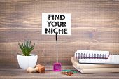 Find Your Niche. Wooden Table With Stationery. poster
