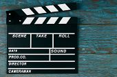 Movie Clapper Board. Black Clapperboard On Blue Wooden Background With Copy Space, Close-up. Cinema  poster