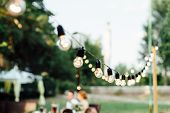Light Bulb Decor In Outdoor Party. Wedding Day poster