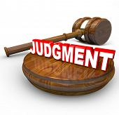 Judgment word on a wooden block and a judge's gavel beside it illustrating the power and decisivenes