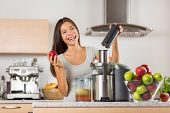 Vegetable juice healthy food juicer machine- Asian woman juicing green and red apple fruits as part  poster
