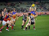 MELBOURNE - AUGUST 20 : Brisbane's Daniel Rich with the ball in heavy traffic during their loss to C