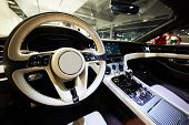 Car Interior Luxury. Interior Of Prestige Modern Car. Dashboard And Steering Wheel. Focus On Steerin poster