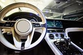 Car Interior Luxury. Interior Of Prestige Modern Car. Dashboard And Steering Wheel. Focus On Steerin poster