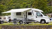 picture of recreational vehicle  - a camper on a camping in germany - JPG