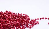 Red Christmas Decorative Beads On A Light Background