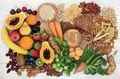 Food with high fiber content for a healthy diet with fruit, vegetables, whole wheat bread, pasta, nu poster