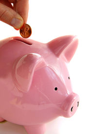 stock photo of save money  - Putting money into the piggy bank on white - JPG