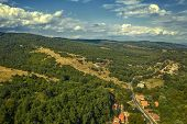 Panoramic Drone Aerial View View Of Mountain Peaks. Hilltops Covered With Forest. Green Nature Backg poster
