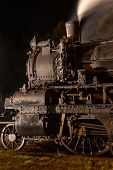 Historic Steam Locomotive -wheels, Rods, Smokebox And Steaming Chimney Close Up At Night Illuminated poster