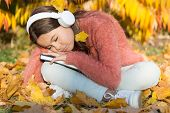 Absorbing Book While Sleeping. Little Child Fell Asleep Listening To Online Book. Small Girl Enjoy L poster