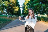 Teenage Girl Schoolgirl, Teenager Headphones Taking Pictures Themselves Phone, Happy Smiling Having  poster