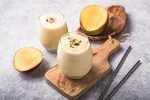 Mango Lassi, Yogurt Or Smoothie. Healthy Probiotic  Cold Summer Drink,mango Lassi Or Lassie , Yogurt poster