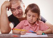 Portrait Of Patience Father Helping Her Daughter With Her Homework Difficulties Homework. poster