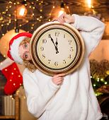 Woman Santa Hat Hold Vintage Clock. Time To Celebrate. New Year Countdown. Unexpectedly Soon. Midnig poster