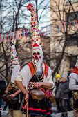 Mummers Perform Rituals To Scare Evil Spirits At Surva Festival At Pernik In Bulgaria. The People Wi poster