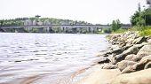 Jyvaskyla, Finland. Lake And The Bridge Of Kuokkala. Waves Hitting Rocks. Beautiful Finnish Nature.  poster