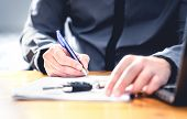Car Loan Form Or Lease Application Document. Man Signing Paper Contract To Sell Premium Vehicle. Buy poster