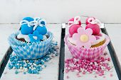 stock photo of mary jane  - Pink cupcake with baby shoes and hearts in pink and blue - JPG
