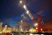 stock photo of shipbuilding  - lifting ship in hong kong harbour - JPG