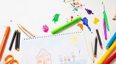 Colorful Paints And Family Home Drawing On White Color Background, Top View poster