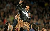 BARCELONA - MAY, 5: FC Barcelona coach Guardiola is launched for his players after the Spanish leagu