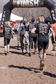POCONO MANOR, PA - APR 28: Participants run to cross the finish line at the Tough Mudder event on Ap