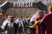 POCONO MANOR, PA - APR 28: Participants use foil wraps to keep warm after the Tough Mudder event on