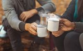 Hands Of International Hikers Cheering Up With Camping Cups, Camping In Forest, Close Up poster