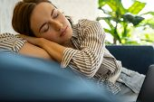 Peaceful Young Woman Sleeping On The Sofa poster