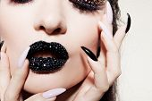 Black Lips Covered With Rhinestones. Beautiful Woman With Black Lipstick On Her Lips And Black And W poster
