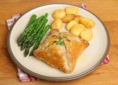 Chicken encroute pastry parcel with asparagus and potatoes