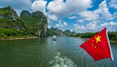 Red Chinese National Flag Fluttering On A Mast On The Deck Of Sightseeing Boatt Full Of Tourists Dep poster