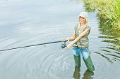 image of fisherwomen  - woman fishing in pond - JPG