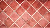 Old porcelain tiles floor texture with tiles of red color and cement of white color poster