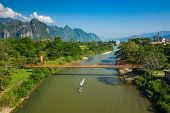 Aerial View Of Village Vang Vieng And  Nam Song River , Laos. Southeast Asia. Photo Made By Drone Fr poster