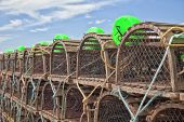 Lobster traps piled up on the wharf in rural Prince Edward Island, Canada.