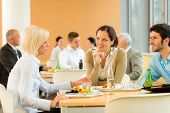 stock photo of canteen  - Cafeteria lunch young business people eat salad at office canteen - JPG