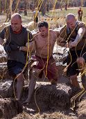 POCONO MANOR, PA - APR 29: A team runs together through obstacle with electrified wires at Tough Mud
