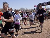 POCONO MANOR, PA - APR 29: Participants run across the starting line at Tough Mudder on April 29, 20