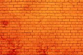 Orange Painted Brick Wall Splashed With Red Paint. poster