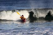 Kayak Surfer In Action