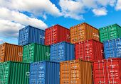 stock photo of loading dock  - Stacked cargo containers in storage area of freight sea port terminal - JPG