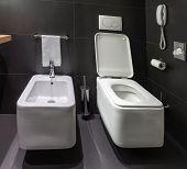 Modern Toilet And Bidet In Bathroom