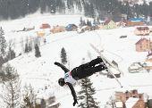 BUKOVEL, UKRAINE - FEBRUARY 23: Baglan Inkarbek, Kazakhstan performs aerial skiing during Freestyle Ski World Cup in Bukovel, Ukraine on February 23, 2013.