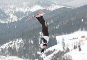 BUKOVEL, UKRAINE - FEBRUARY 23: Naoya Tabara, Japan performs aerial skiing during Freestyle Ski World Cup in Bukovel, Ukraine on February 23, 2013.