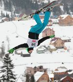 BUKOVEL, UKRAINE - FEBRUARY 23: Lloyd Wallace, Great Britain performs aerial skiing during Freestyle Ski World Cup in Bukovel, Ukraine on February 23, 2013.